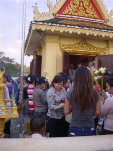 Burning incense at the riverside temple...