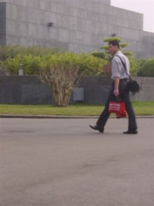 Employment scheme - carrying red bags around...