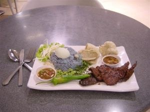 Local food, fancy style in the malls: blue rice