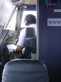 Is that the plane's manual the pilot reads?