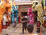 Chinese troup dancing to attract good luck to Chinese business